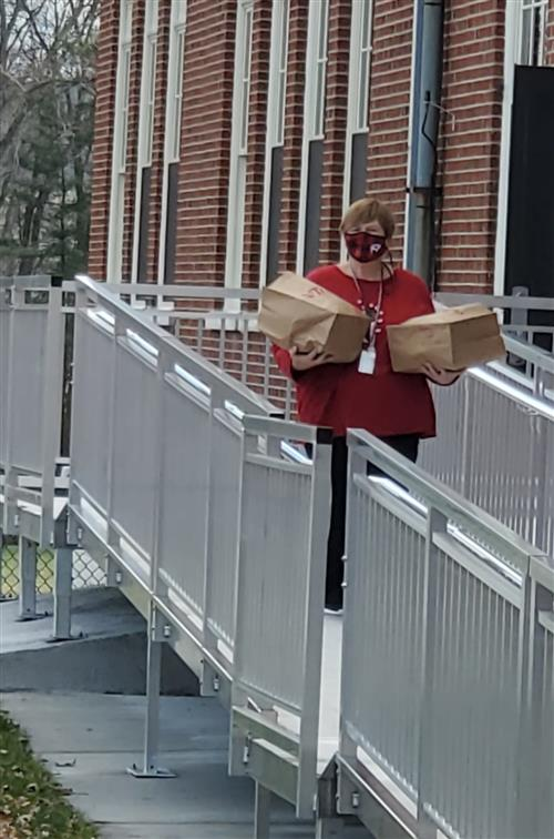 Miss Alfes delivering holiday lunches.